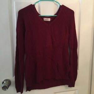 Women's maroon sweater.